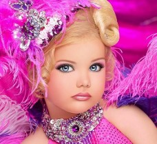 "This is former ""America's Top Child Beauty Pageant Star"" Eden Wood. I didn't even know we had a top child beauty pageant star until today, and that bothers me because of pedophiles. No child of mine is wearing make-up until they're 15. Source: Brisbanetimes.com.au"